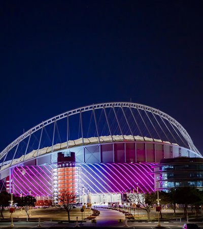 3-2-1 Qatar Olympic Sports Museum illuminated at night with brightly coloured lights