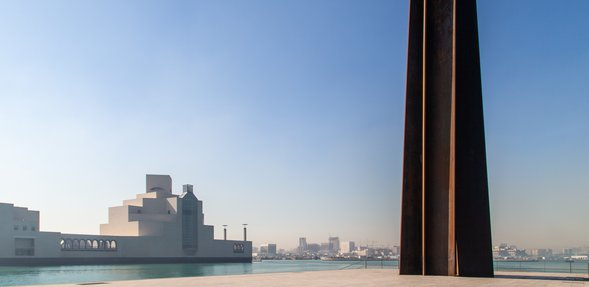 A wide-angle view of Richard Serra's sculpture '7' located right outside the Museum of Islamic Art, Doha