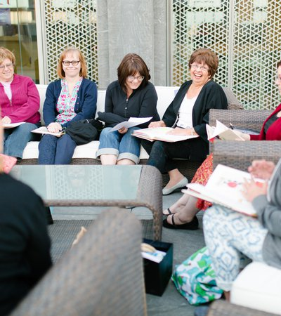A group of women meeting outdoors at MIA