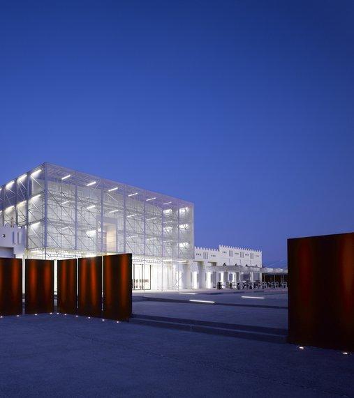 Exterior of Mathaf: Arab Museum of Modern Art lit up at night