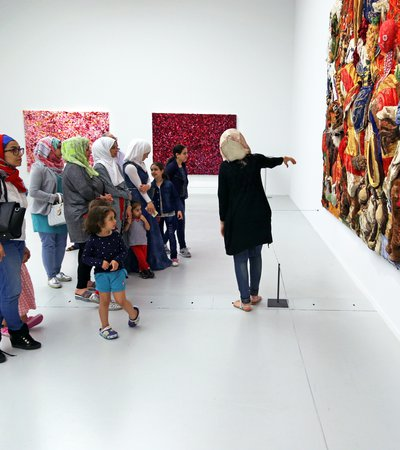 A group of school children visit Mathaf as part of the Years of Culture programme