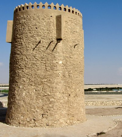 The Al Khor stone tower, Qatar, seen with a bright blue sky behind it