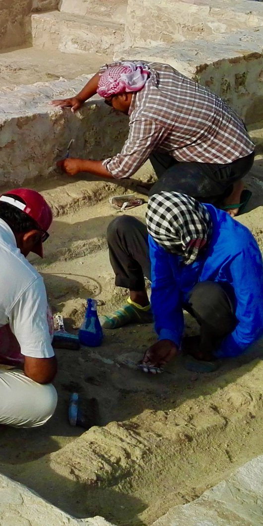 Four archaeologists excavating the remains of Al Shamali houses