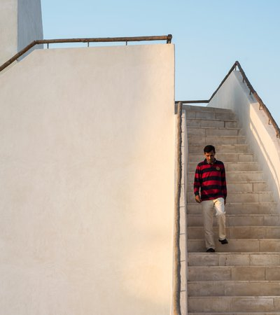 Medium shot of a visitor coming down the steps of Barzan Tower