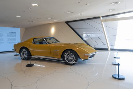 A shot of a yellow Chevrolet Corvette 1972 model at the Mawater Gallery, NMoQ  CORVETTE 1972