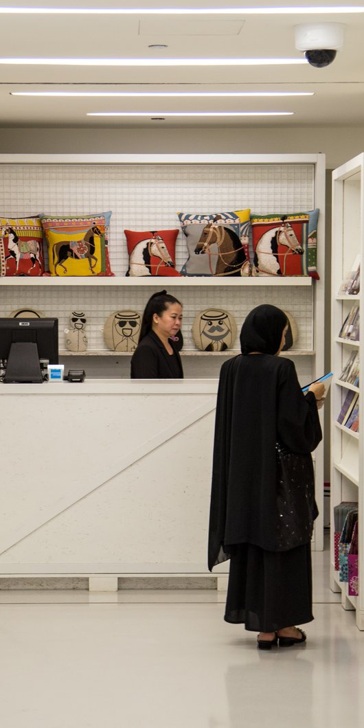 A woman shopping in Mathaf's gift shop