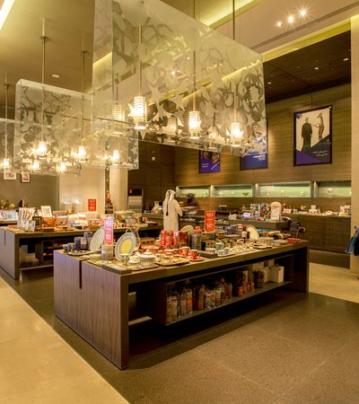 Interior view of MIA's gift shop with a Qatari man purchasing items at the service counter