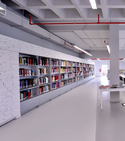 Book shelves with colourful books in Mathaf's library