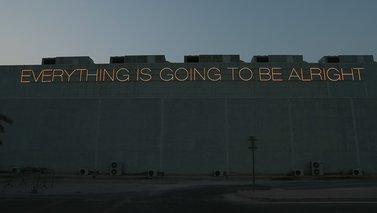 """Martin Creed's neon lettering spelling out """"Everything is Going to be Alright"""" installed outside the Al Riwaq gallery"""