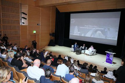 Auditorium in the Museum of Islamic Art filled with audience members listening to a conversation with Luc Tuymans