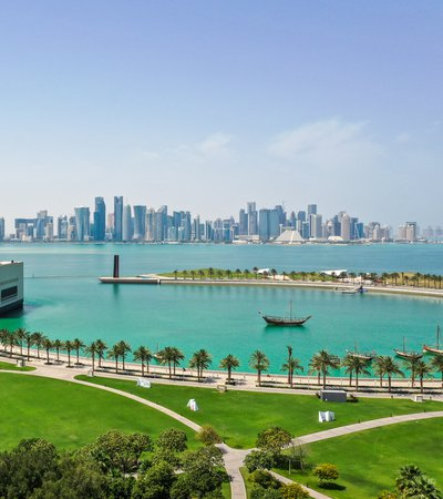 A view of the Museum of Islamic Art with the iconic Doha skyline and the corniche right behind it