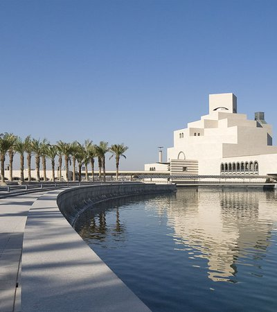 A wide-angled shot showing the exterior of MIA and surrounding palm trees of the MIA Park