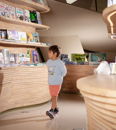 A little boy visiting NMoQ's children's gift shop