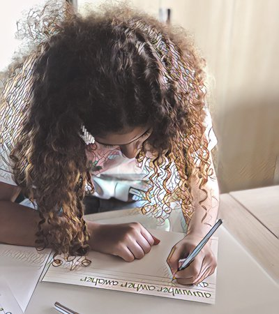 Close-up of a little girl writing on a paper