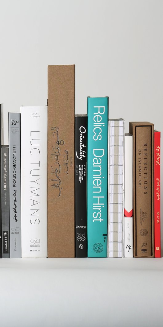 All Qatar Museums publications lined up in a medium shot