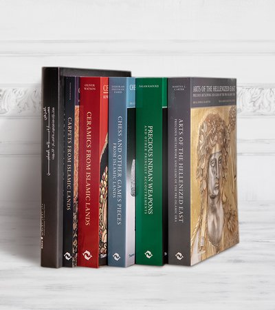 A collection of display books and publications from In-Q