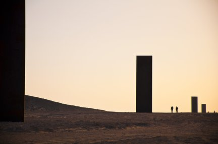 A wide shot of Richard Serra's East-West-West-East at sunset