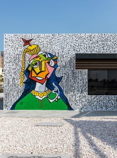 A mural depicting a Qatari woman figure in a cubist fashion