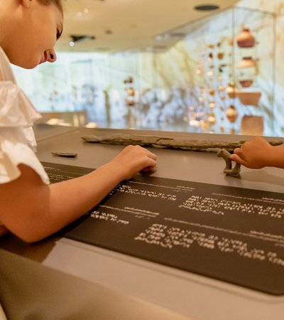 Children using accessible tactile information panels at NMoQ