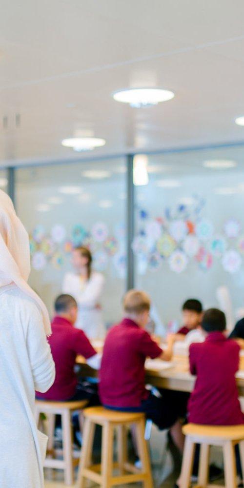 Instructor teaching children at a workshop
