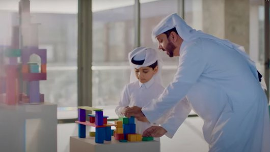 A Qatari father and son play at Dadu, Children's Museum of Qatar